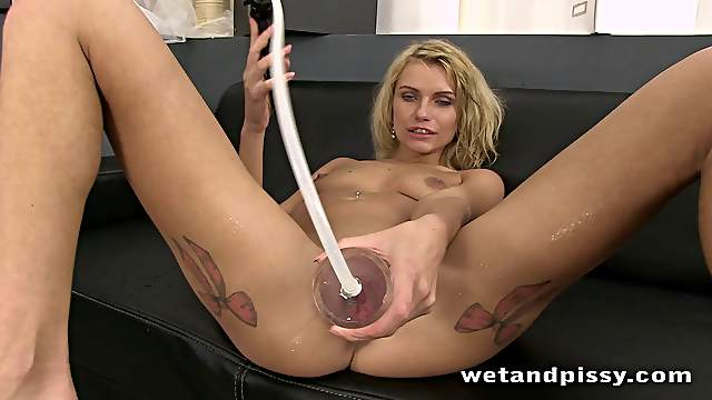 Hot blond with small natural tits has pissing fetish and uses toys