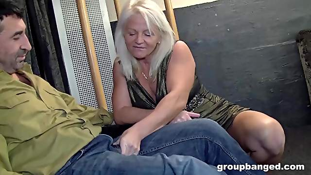 Mature MMF threesome with blonde MILF in a tight dress