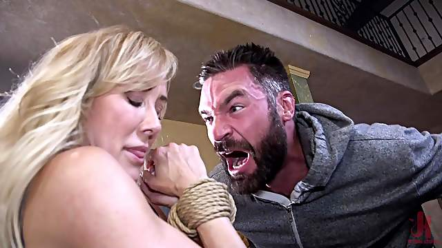 Blonde slender MILF Brandi Love sprayed with cum after a bondage fuck