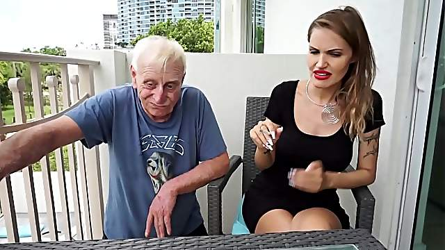Skinny blonde smoking backstage with an old grandpa
