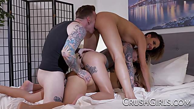Three pornstars sharing a hard cock