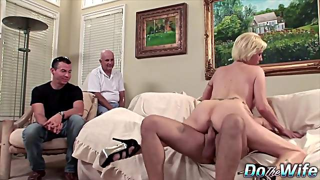 Swinger wives getting fucked by another guy in front of her cuck hubby at a porn set
