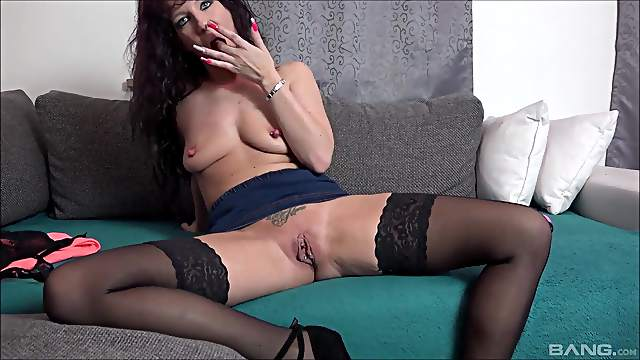 Mature solo model Samy Saint in stockings pleasures her pussy