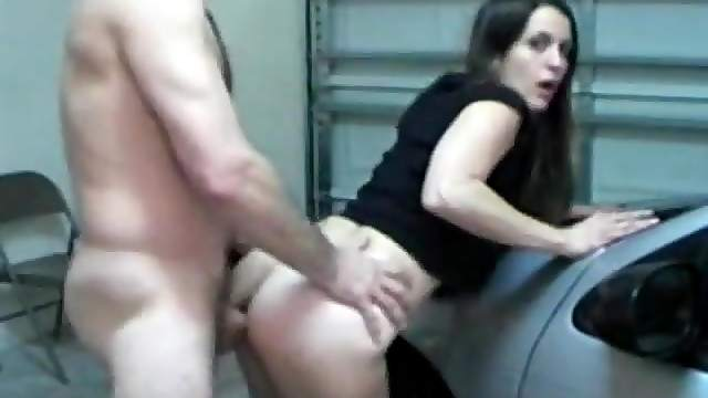 He bends his lady over a car and fucks her