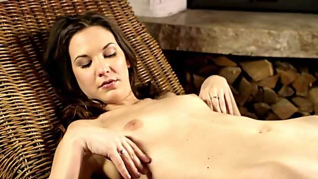 Beauty masturbates her bald pussy