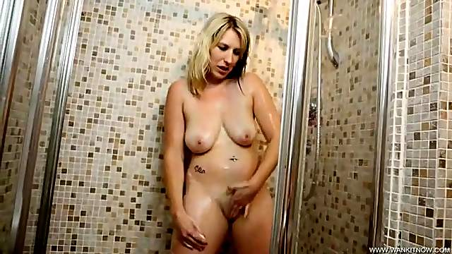 Curvy British girl in the shower gives a bit of JOI