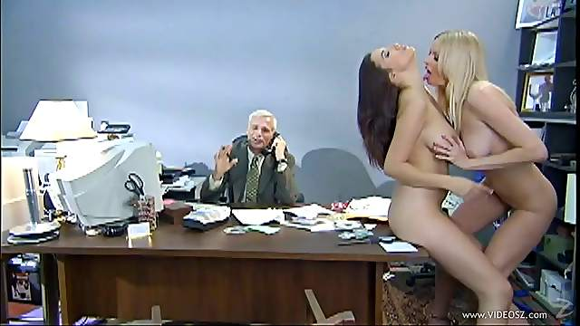 Seductive babes with big tits caressing wildly at the office with an executive on the sight