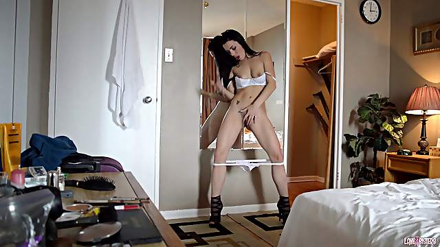 Red hot brunette solo model in high heels and a sexy thong moaning as she masturbates