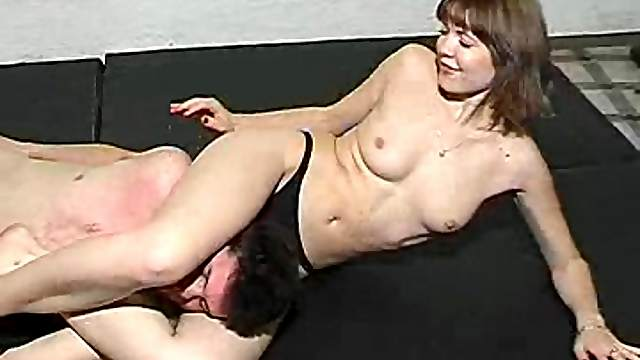 Thong-clad brunette with nice big tits wrestling a guy