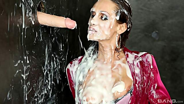 Brunette in a silk blouse gets covered in slime at a gloryhole