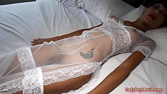 Thai shemale doll Sakura in a sexy lingerie set of white stockings a