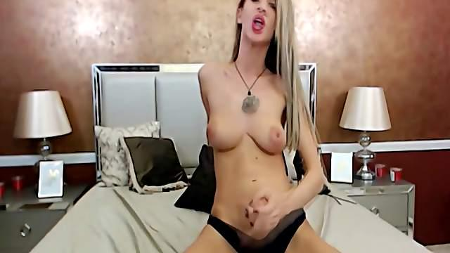 Hot and busty shemale loves handjob her big dick