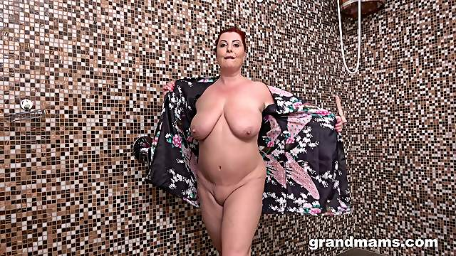 Solo redhead BBW whore spreads her legs to play with a dildo