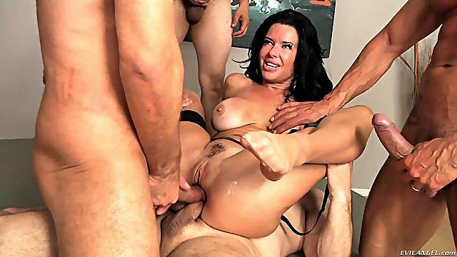Insatiable black haired Milf gets all her orifices full of cock