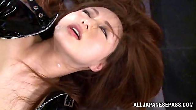 A bad girl in leather gets fucked doggystyle at gunpoint
