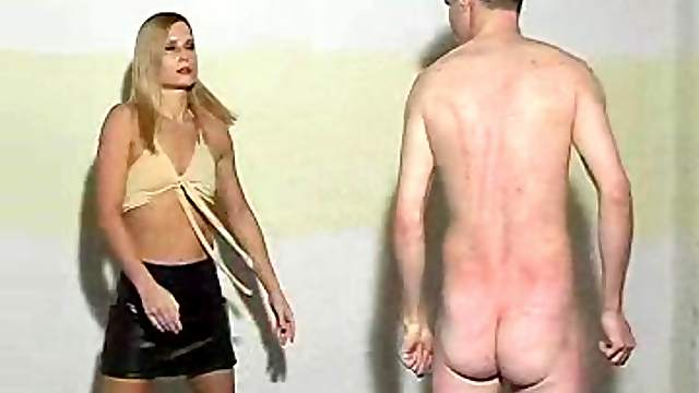 Mini-skirt clad blonde with a slim body wrestling a guy