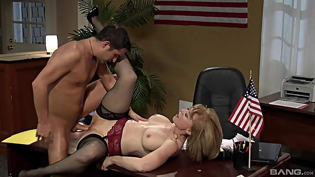 Dirty mature Nina Hartley takes off her clothes for office sex