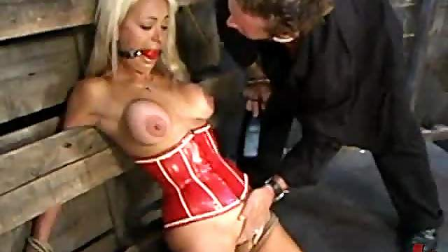 Blonde in red bondage whipped and fucked