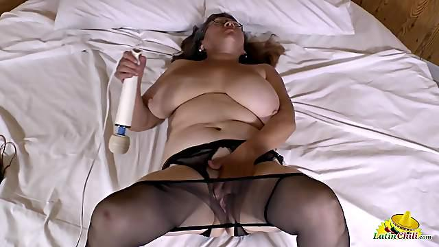Mature pussy is all wet from her vibrator play