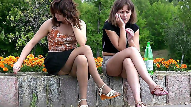 Pretty babes are getting upskirt outdoors