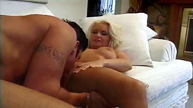 Blonde pornstar receives massive cumshot over her tits