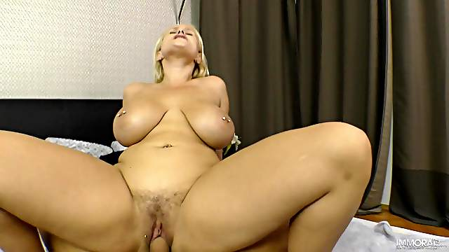 Busty MILF handles young dick with great care