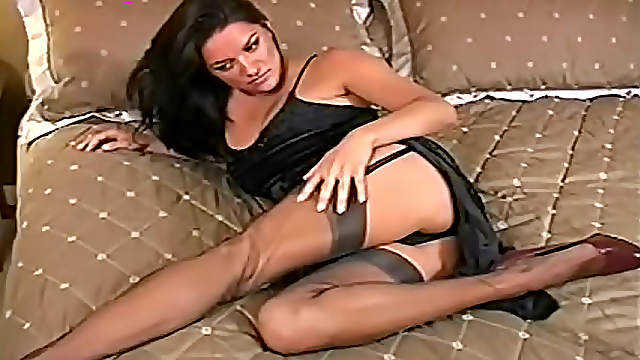 Striptease from little black dress and stockings
