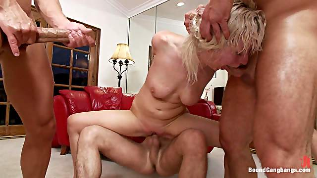 Blonde Gets Double Penetrated while Deepthroated in Gangbang