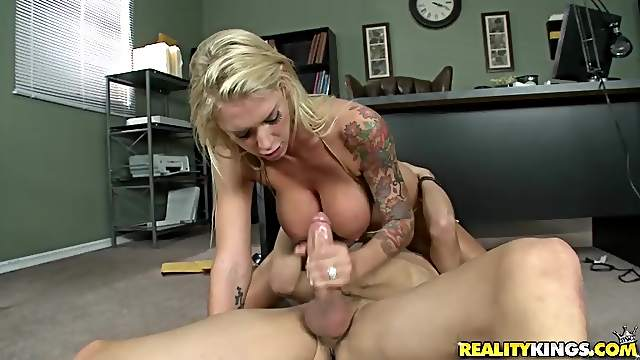 Big titty blonde with tattoos sucks dick