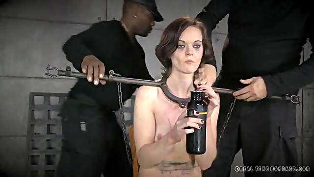 Metal bar bondage for a slender brunette beauty