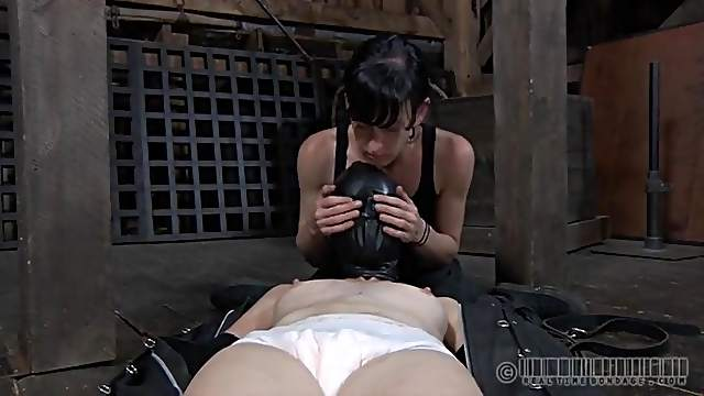 Full leather body bag wrapped around a sub girl