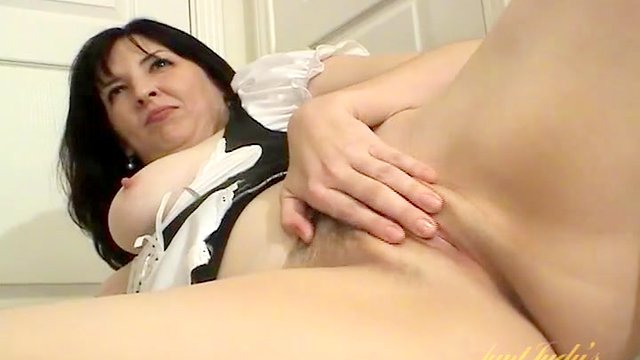 Milf teases in her sexy French maid costume