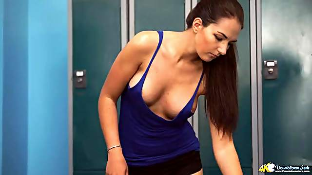 Sporty beauty in tight gym clothes offers her cleavage