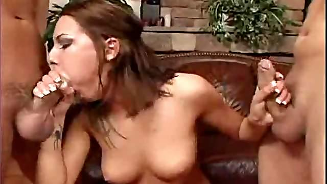 Girl with sexy tattoo sucking two dicks