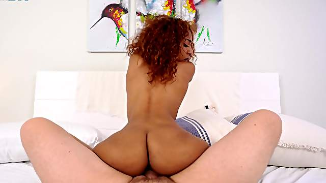 Curly babe rides in charming mode while screaming