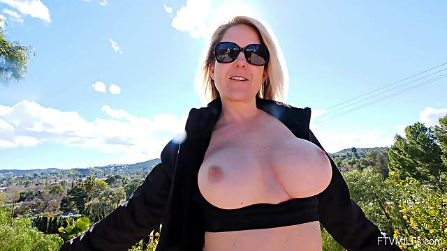 Mature flashes the big tits while toying her wet cunt like a whore