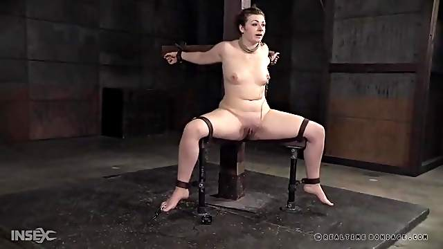 Electro shock pain makes the bound girl suffer