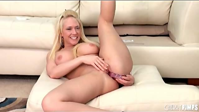 Curvy blonde Kagney Linn Karter fucks a dildo