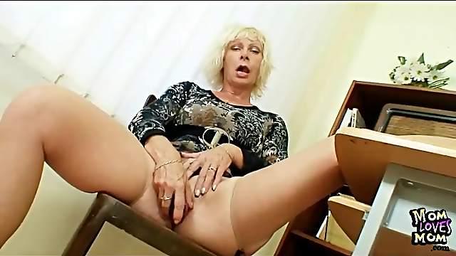 Mature teacher in skintight dress masturbates