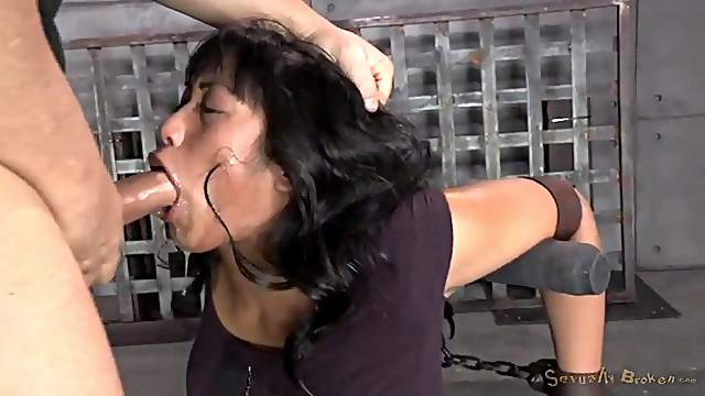 Face fucked girl is bound by leather straps